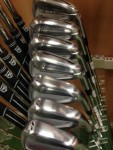 A set of golf irons in a rack - golf club fitting